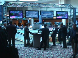 The hotel atrium was the central traffic area between the entrance and the presentation rooms. Plasma displays ran a Director-based application with a Tech 2000 theme animation and real-time updating information such as the current presentations, schedule