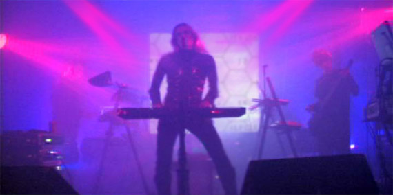 the rock band Moodorgan performs in Los Angeles in November 2009. LED lighting, scanners, lasers, FX and video projections are all sequencer/MIDI/DMX-controlled and sync'ed.