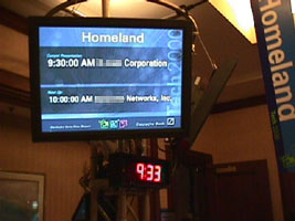Plasma displays at the entrance to each presentation room showed the name of the current presenter and the name of the presenter to follow.  All information was automatically updated from the backend database.